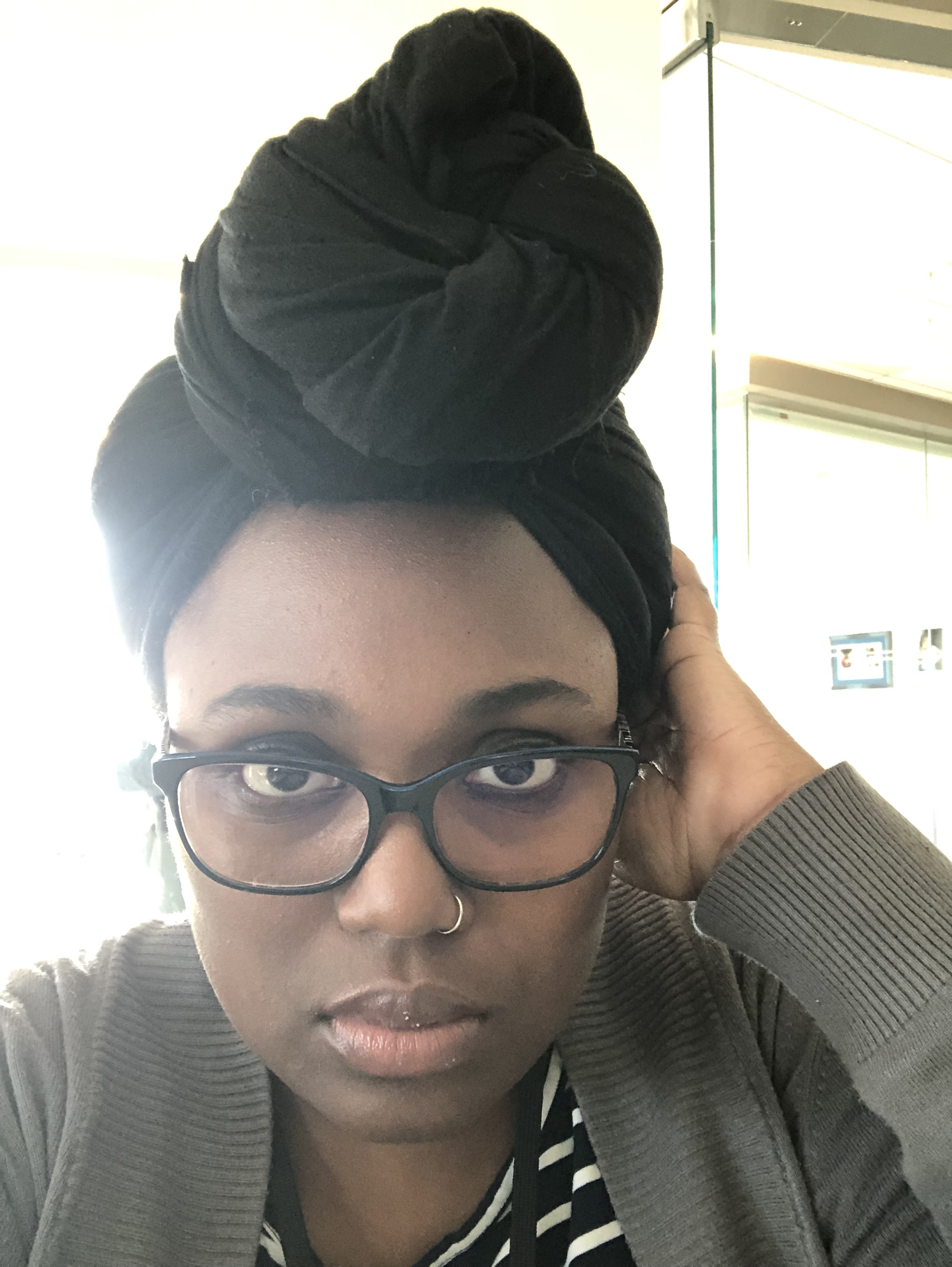 Selfie of Ally with he headwrap looking better